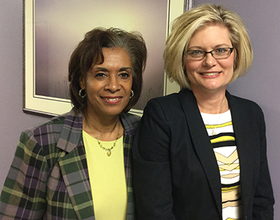 Northwest Hospital Foundation chairperson Denise Jones (left) welcomes the foundation's new executive director, Theresa Edder (right), during a recent committee meeting.